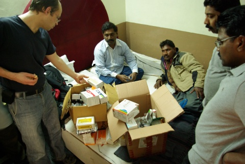 Selecting and packing the required pharmaceuticals.